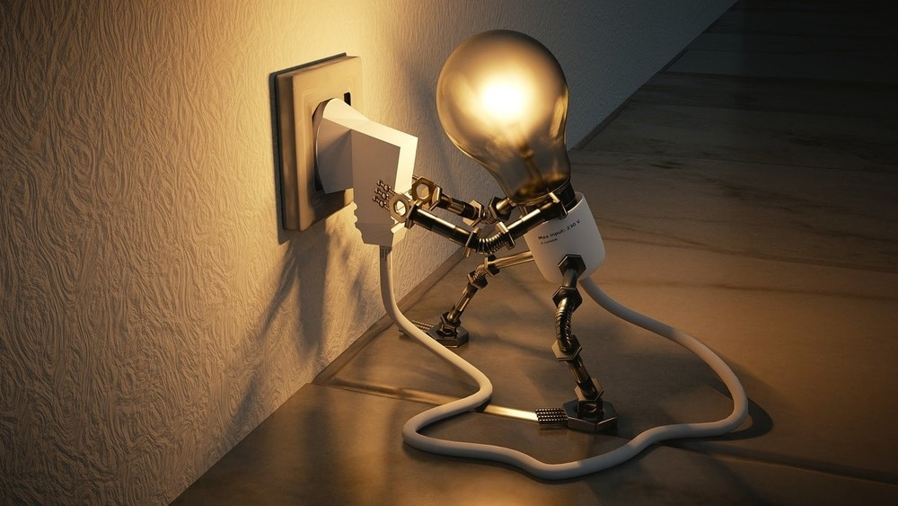 Cartoon lightbulb plugging itself into the wall